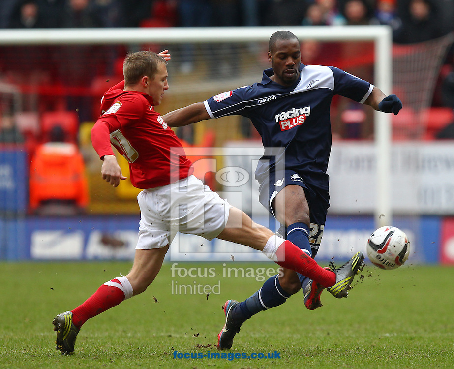 Picture by John  Rainford/Focus Images Ltd +44 7506 538356.16/03/2013.Chris Solly of Charlton Athletic gets in a challenge on Dany N'Guessan of Millwall during the npower Championship match at The Valley, London.