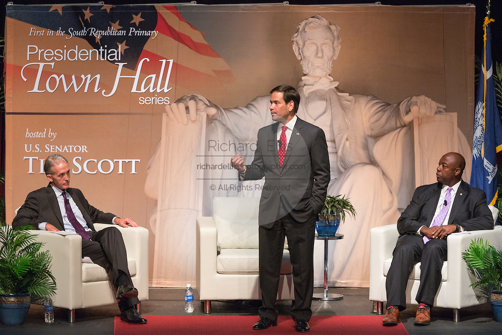 Senator and GOP presidential candidate Marco Rubio gives opening remarks during Tim's Presidential Town Hall meeting as Sen. Tim Scott and Rep. Trey Gowdy look on August 7, 2015 in North Charleston, SC.