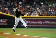 Jun. 18 2011; Phoenix, AZ, USA; Arizona Diamondbacks third basemen Melvin Mora (4) throws the force out at first base during the first inning against the Chicago White Sox at Chase Field. Mandatory Credit: Jennifer Stewart-US PRESSWIRE.