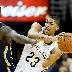 Oct 30, 2013; New Orleans, LA, USA; New Orleans Pelicans power forward Anthony Davis (23) is defended by Indiana Pacers shooting guard Lance Stephenson (1) during the first half of a game at New Orleans Arena. Mandatory Credit: Derick E. Hingle-USA TODAY Sports