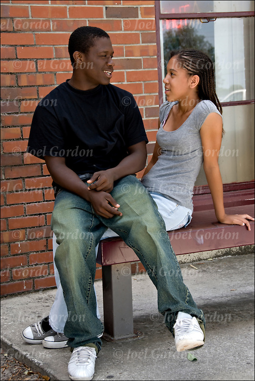 African American male and female student outdoors during lunch period talking