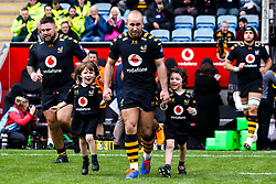 Dan Robson of Wasps leads the side out with mascots - Mandatory by-line: Robbie Stephenson/JMP - 12/10/2019 - RUGBY - Ricoh Arena - Coventry, England - Wasps v Worcester Warriors - Premiership Rugby Cup