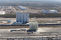 Fracking sand silos at Gardendale Rail Terminal, Cotulla, TX. Larger silos in backgraound belong to Chesapeake subsidery.