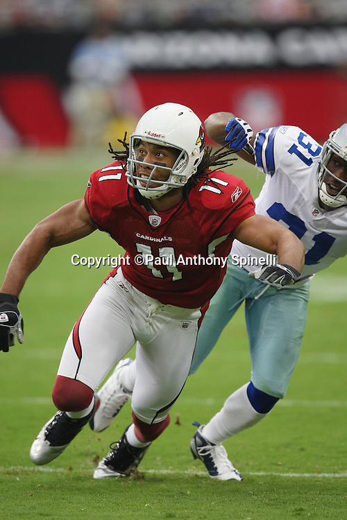 GLENDALE, AZ - OCTOBER 12: Wide receiver Larry Fitzgerald #11 of the Arizona Cardinals stretches for a pass broken up by rookie cornerback Mike Jenkins #31 of the Dallas Cowboys at University of Phoenix Stadium on October 12, 2008 in Glendale, Arizona. The Cardinals defeated the Cowboys 30-24. ©Paul Anthony Spinelli *** Local Caption *** Larry Fitzgerald;Mike Jenkins