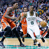 21 December 2012:  Boston Celtics point guard Rajon Rondo (9) drives past Milwaukee Bucks point guard Brandon Jennings (3) and Milwaukee Bucks center Larry Sanders (8) during the Milwaukee Bucks 99-94 overtime victory over the Boston Celtics at the TD Garden, Boston, Massachusetts, USA.