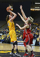 February 11 2013: Iowa Hawkeyes center Morgan Johnson (12) puts up a shot over Nebraska Cornhuskers guard Lindsey Moore (00) and forward Emily Cady (23) during the first half of the NCAA women's basketball game between the Nebraska Cornhuskers and the Iowa Hawkeyes at Carver-Hawkeye Arena in Iowa City, Iowa on Monday, February 11 2013.