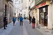 food shoppers waiting outside during Covid 19 crisis France Limoux April 2020