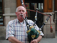 Busker / Bagpiper - a touch of Scotland in that most English of towns, Chester, England, UK. Ref: 200005631..Copyright Image from Victor Patterson, 54 Dorchester Park, Belfast, UK, BT9 6RJ..Tel: +44 28 9066 1296.Mob: +44 7802 353836.Voicemail +44 20 8816 7153.Skype: victorpattersonbelfast.Email: victorpatterson@mac.com.Email: victorpatterson@ireland.com (back-up)..IMPORTANT: If you wish to use this image or any other of my images please go to www.victorpatterson.com and click on the Terms & Conditions. Then contact me by email or phone with the reference number(s) of the image(s) concerned.