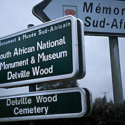Signs in both English and French for the ‪Delville Wood South African national memorial‬, museum and the ‪Delville‬ cemetery