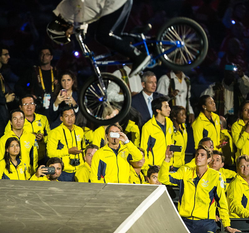 Athletes watch as BMX riders perform during the opening ceremonies at the Pan American Games in Toronto, Canada, July 10,  2015.  AFP PHOTO/GEOFF ROBINS