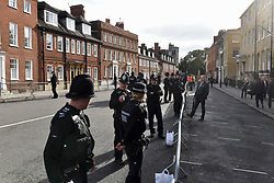 © Licensed to London News Pictures. 12/10/2018. WINDSOR, UK.  Police officers patrol in Windsor ahead of the royal wedding of Princess Eugenie and Jack Brooksbank.  Princess Eugenie, 28, the younger daughter of the queen's third child Prince Andrew and his ex-wife Sarah Ferguson, the Duchess of York, will marry Jack Brooksbank, a 32-year-old drinks executive, in Windsor Castle before taking part in a short carriage procession through Windsor town.  This is the second royal wedding in Windsor in 2018, Prince Harry married Meghan Markle in May.  Photo credit: Stephen Chung/LNP