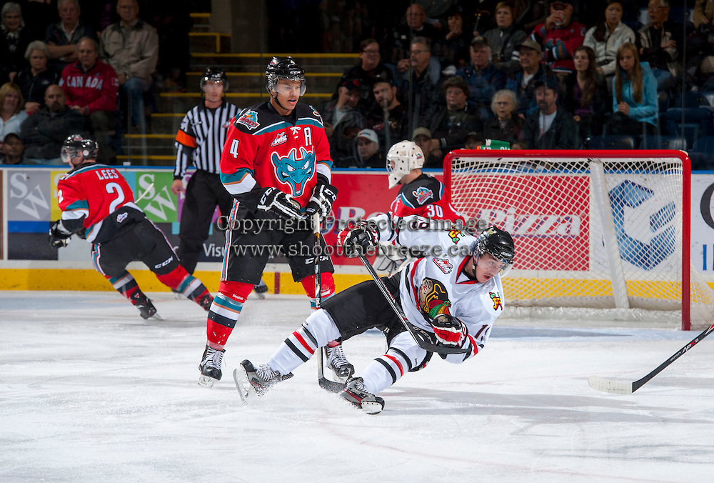 KELOWNA, CANADA - OCTOBER 4:  Madison Bowey #4 of the Kelowna Rockets checks Nic Petan #19 of the Portland Winterhawks  at the Kelowna Rockets on October 4, 2013 at Prospera Place in Kelowna, British Columbia, Canada (Photo by Marissa Baecker/Shoot the Breeze) *** Local Caption ***