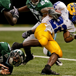 Sep 26, 2009; New Orleans, LA, USA; McNesse State Cowboys running back Todd Pendland (22) runs against the Tulane Green Wave defense at the Louisiana Superdome. Tulane defeated McNeese State 42-32. Mandatory Credit: Derick E. Hingle-US PRESSWIRE
