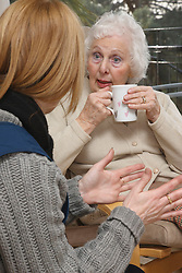 Elderly lady with carer.