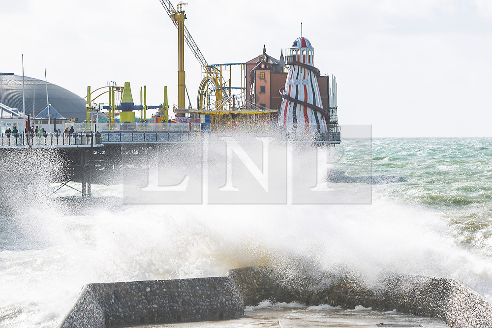 © Licensed to London News Pictures. 28/09/2019. Brighton, UK. Members of the public take to the beach in Brighton and Hove as strong winds and powerful waves ora hitting the seaside resort. Photo credit: Hugo Michiels/LNP