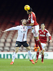 Bristol City's Derrick Williams battles for the high ball with Milton Keynes Dons' Dean Bowditch - Photo mandatory by-line: Joe Meredith/JMP - Tel: Mobile: 07966 386802 18/01/2014 - SPORT - FOOTBALL - Ashton Gate - Bristol - Bristol City v MK Dons - Sky Bet League One