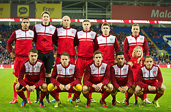 11.10.2013, City Stadion, Cardiff, WAL, FIFA WM Qualifikation, Wales vs Mazedonien, Gruppe A, im Bild Wales' players line up for a team group photograph before the 2014 FIFA World Cup Brazil Qualifying Group A match against Macedonia at the Cardiff City Stadium. Back row L-R: Hal Robson-Kanu, goalkeeper Wayne Hennessey, James Collins, Simon Church, Declan John Craig Bellamy. Front row L-R: Aaron Ramsey, Chris Gunter, Andy King, Neil Taylor, David Vaughan.the FIFA World Cup Qualifier Group A Match between Wales and Macedonia at the City Stadium, Cardiff, Wales on 2013/10/11. EXPA Pictures © 2013, PhotoCredit: EXPA/ Propagandaphoto/ David Rawcliffe<br /> <br /> ***** ATTENTION - OUT OF ENG, GBR, UK *****