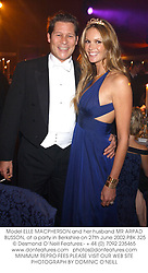 Model ELLE MACPHERSON and her husband MR ARPAD BUSSON, at a party in Berkshire on 27th June 2002.PBK 325
