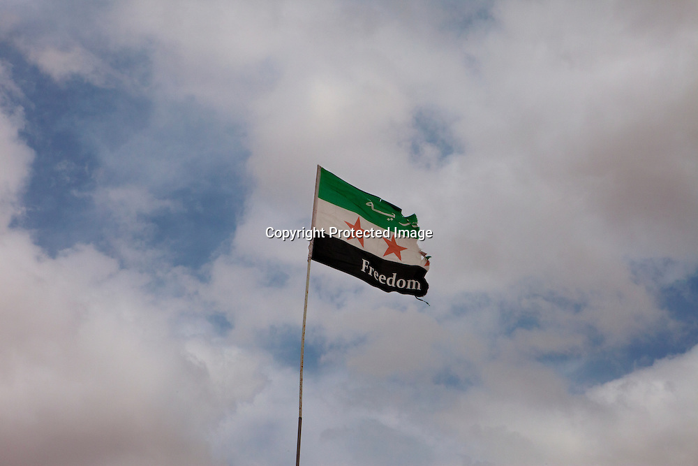 The flag-flying of Free Syrian Army - the oposition forces against Bashar al - Assad regime in Zaatari Refugee Camp in Mafraq, Jordan