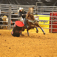 Libby Ezell | BUY AT PHOTOS.DJOURNAL.COM<br /> One of the Cowgirls in the Cowgirl Barrel Racing event knocks over a barrel as she rounds it with great speed