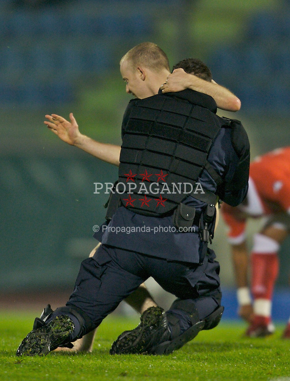 San Marino, San Marino - Wednesday, October 17, 2007: A Wales' streaker is tackled by San Marino riot police during the Group D UEFA Euro 2008 Qualifying match at the Serravalle Stadium. (Photo by David Rawcliffe/Propaganda)