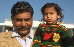 Father holding young child,