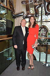 ANDREW NEIL and OLIVIA COLE at the 3rd birthday party for Spectator Life magazine hosted by Andrew Neil and Olivia Cole held at the Belgraves Hotel, 20 Chesham Place, London on 31st March 2015.
