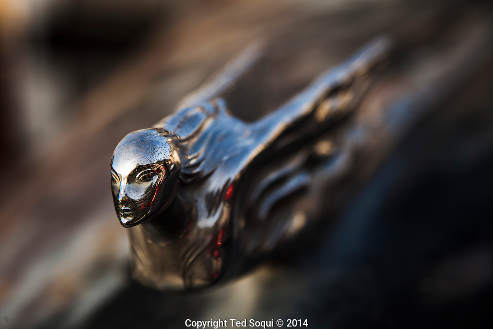 A pre-war Cadillac hood ornament.<br /> U.S. Route 66, also known as the Mother Road, in the Mojave desert of California. The two major connector cites in the Mojave desert are Barstow and Amboy. U.S. Route 66 was the first major east west highway for the US, starting in Chicago, Il and ending in Santa Monica, CA. The 2,448 mile long highway was built in November 11,1926. Most of Route 66 has been decommissioned, but there are several parts that are now historically preserved.