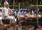 Balinese priest leading a ceremony at Pura Luhur Dalem temple, Penebel, Bali