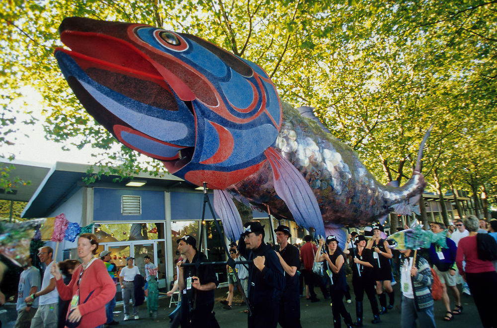 USA, Washington, Seattle, Seattle Center. Huge salmon held aloft in parade at annual Bumbershoot Festival