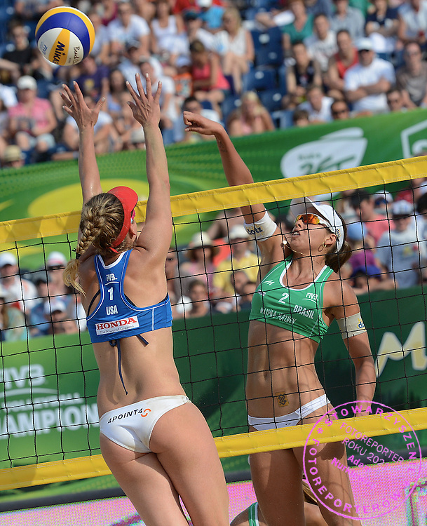 STARE JABLONKI POLAND - July 6: Liliane Maestrini  and Barbara Seixas De Freitas of Brazil celebrate bronze medal during the FIVB Beach Volleyball World Championships on July 6, 2013 in Stare Jablonki Poland.  (Photo by Piotr Hawalej)