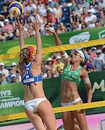 STARE JABLONKI POLAND - July 6: Liliane Maestrini  and Barbara Seixas De Freitas of Brazil celebrate bronze medal during the FIVB Beach Volleyball World Championships on July 6, 2013 in Stare Jablonki Poland.  (Photo by Piotr Hawalej)