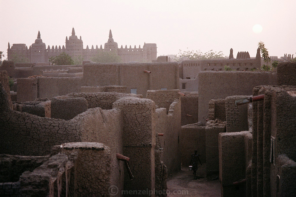 In the distance is the mud-walled Great Mosque in the African city of Djenne, in Mali was built decades ago on the ruins of a 13th-century mosque. Published in Material World, page 20-21.