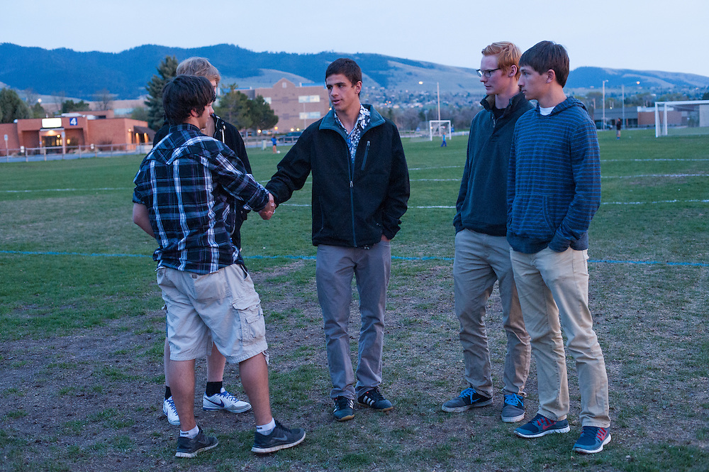 Students and friends of German exchange student, Diren Dede, who was slain on April 27, 2014, greet each other at Dede's candlelight vigil at the Fort Missoula soccer field where Dede played. L-R: Nathan Mahler, Kyle Higgins, Macky Scott, Chaucer Larson, Garret Leach.
