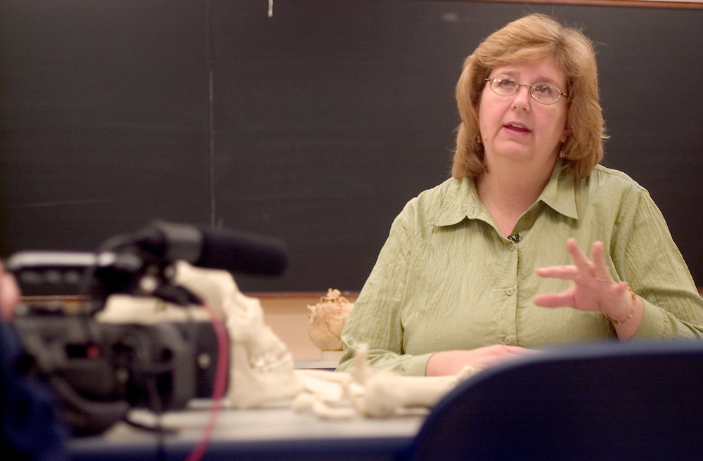 16832Forensic Video: Horizons Company : Nancy E Tatarek..Ohio University Professor Nancy E Tatarek is filmed by Chris Weber and Kevin Jones(blue shirt) from Horizon's Company. They are filming the Forensics Department to make education videos to be viewed in high schools.