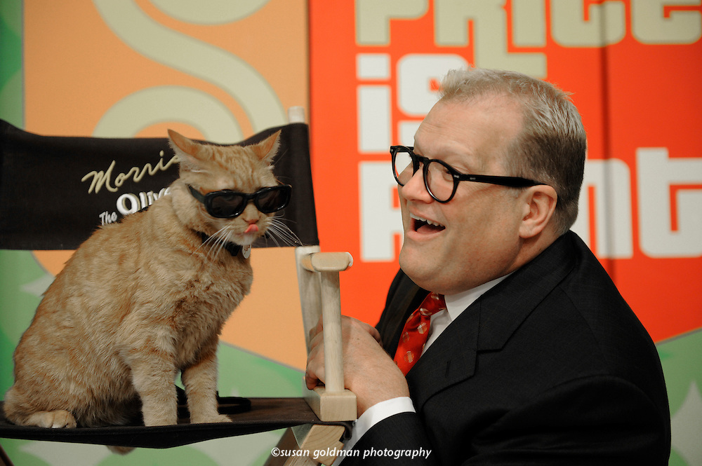 Morris the Cat and host Drew Carey celebrate the adoption of the one millionth cat in the Morris' Million Cat Rescue Campaign on the set of The Price is Right, in Los Angeles. Cat owners nationwide can upload their favorite cat moment caught on video to 9Lives.com. Photo/9Lives, Susan Goldman.