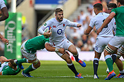 England player Elliot Daly breaks an Irish tackle in the first half during the England vs Ireland warm up fixture at Twickenham, Richmond, United Kingdom on 24 August 2019.