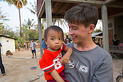 ICS volunteer Dan Hensman entertaining the children in his host home, in the village of in Banteay Char, near Battambang, Cambodia.
