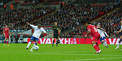 LONDON, ENGLAND - Tuesday, September 6, 2011: England's Ashley Young scores his teams first goal during the UEFA Euro 2012 Qualifying Group G match against Wales at Wembley Stadium. (Pic by Gareth Davies/Propaganda)