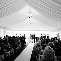 Justin and Melissa get married in a tent alongside Lake Washington at their Seattle wedding.