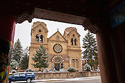 The Cathedral Basilica of St. Francis of Assisi in the historic district during a winter snowfall December 12, 2015 in Santa Fe, New Mexico.