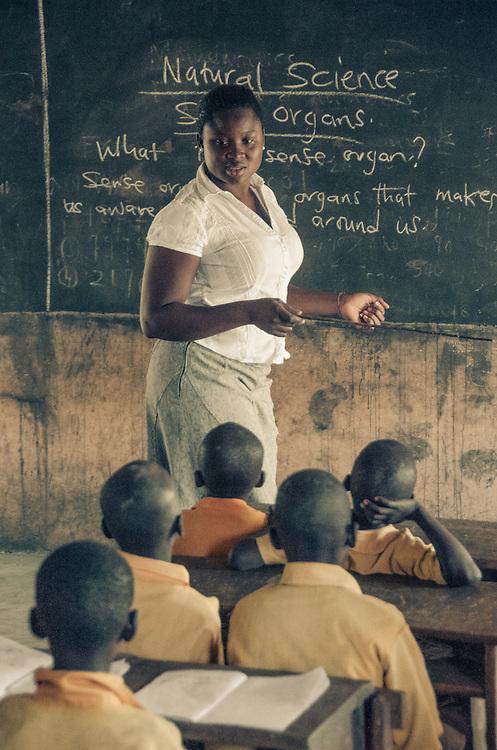 A recent graduate, now a teacher, leads her class in the studies.