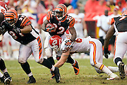 KANSAS CITY, MO - SEPTEMBER 10:  Running back Rudi Johnson #32 of the Cincinnati Bengals gets tackled by defensive end Jared Allen #69 of the Kansas City Chiefs during a game on September 10, 2006 at Arrowhead Stadium in Kansas City, Missouri.  The Bengals won 23 to 10.  (Photo by Wesley Hitt/Getty Images)***Local Caption***Rudi Johnson and Jared Allen