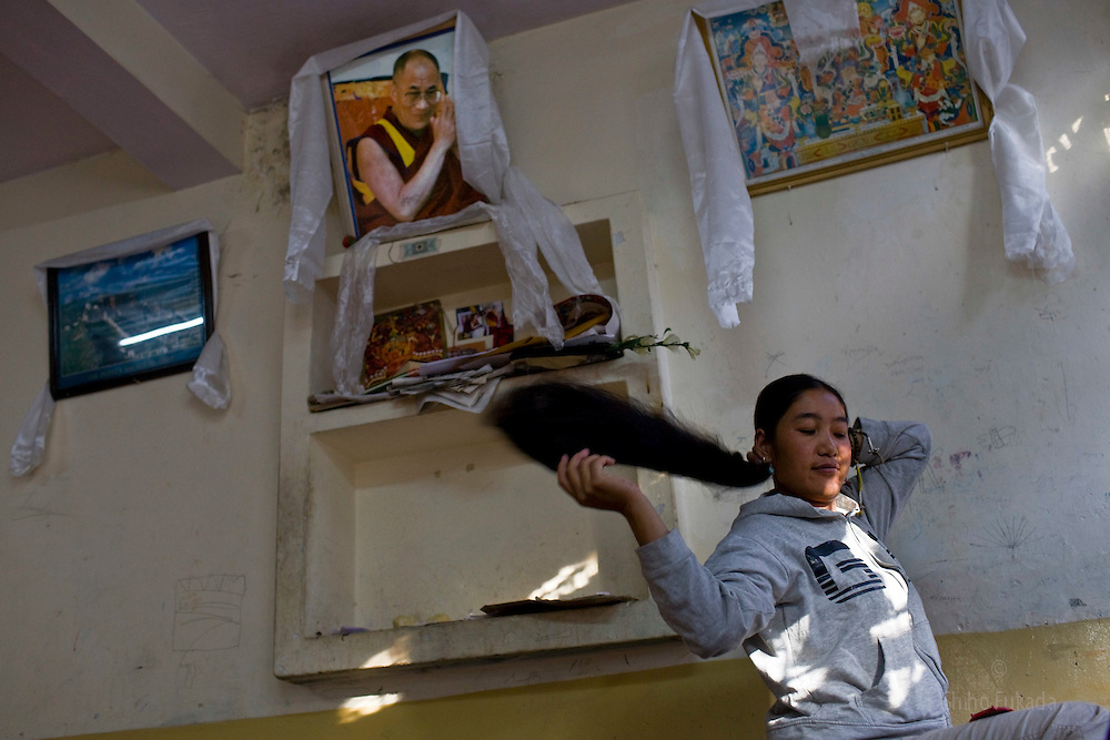 A Tibetan refugee is seen at Reception Center, a temporary shelter for newly arrived Tibetan refugees in McLeod Ganj, Dharamsala, India, where the Dalai Lama settled after fleeing Tibet in 1959 after a failed uprising against Chinese rule, June 3, 2009.