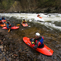 A group of kayakers at a hole in Tariffville Gorge on the Farmington River in Tariffville, Connecticut.