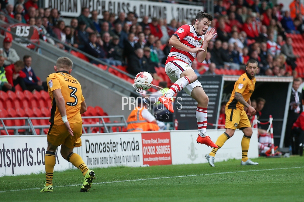 Doncaster Rovers midfielder Harry Middleton (14) tires to block the clearance during the EFL Sky Bet League 2 match between Doncaster Rovers and Newport County at the Keepmoat Stadium, Doncaster, England on 17 September 2016. Photo by Simon Davies.