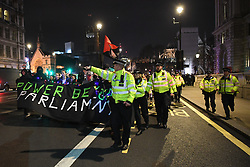 © Licensed to London News Pictures. 13/12/2019. London, UK.  Hours after Boris Johnson won the 2019 general election, Antifa (anti facist) demonstrators crossed Westminster Bridge and marched on Downing Street where police intercepted them.  Photo credit: Guilhem Baker/LNP