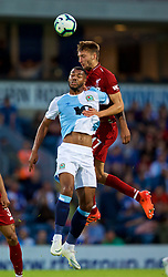 BLACKBURN, ENGLAND - Thursday, July 19, 2018: Liverpool's Nathaniel Phillips and Blackburn Rovers' Joe Nuttall during a preseason friendly match between Blackburn Rovers FC and Liverpool FC at Ewood Park. (Pic by David Rawcliffe/Propaganda)