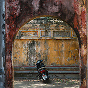 Motorbike parked under archway at Hue Imperial City