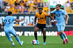 Adama Traore of Wolverhampton Wanderers takes on Jay Rodriguez of Burnley - Mandatory by-line: Robbie Stephenson/JMP - 25/08/2019 - FOOTBALL - Molineux - Wolverhampton, England - Wolverhampton Wanderers v Burnley - Premier League
